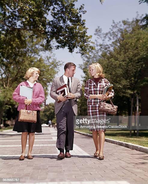1960s 3 STUDENTS WALKING...