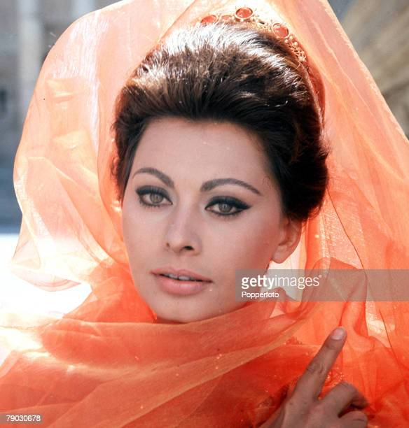 1960s A portrait the Italian actress Sophia Loren wearing a following orange coloured veil