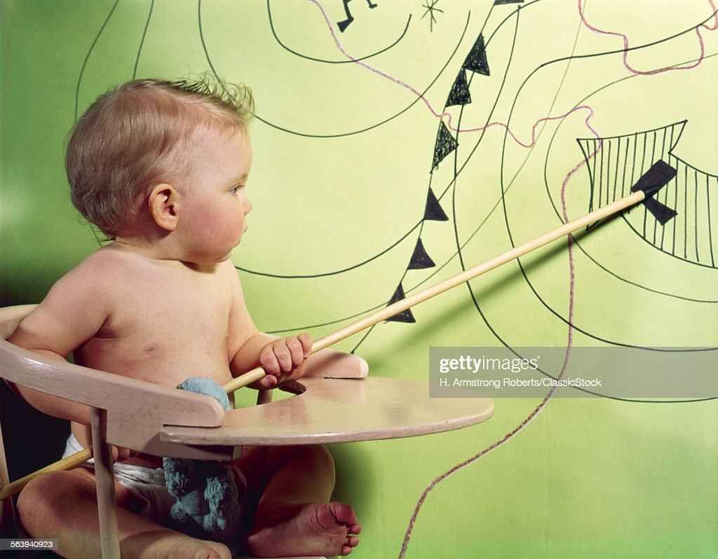 1960s BABY IN HIGH CHAIR...