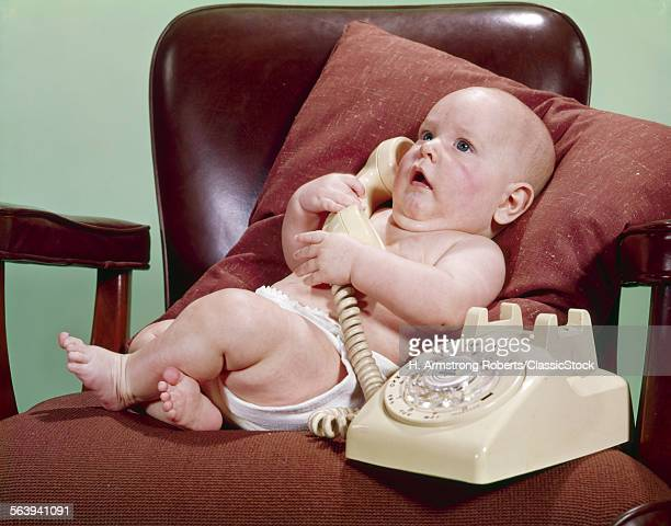1960s BABY IN OFFICE CHAIR...