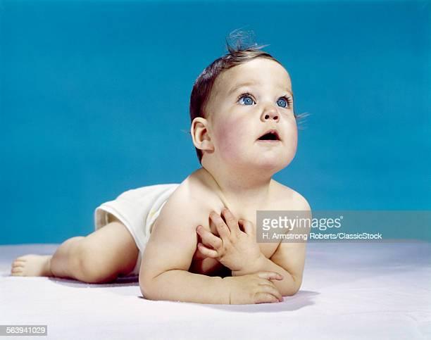 1960s BABY LYING ON...
