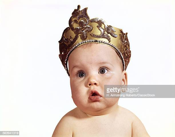 1960s BABY WEARING CROWN...