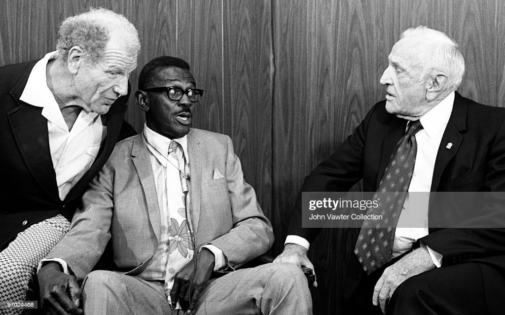 Bill Veeck, former major league and negro league pitcher Leroy 'Satchel' Paige and former major league player and manager Charles Dillon 'Casey' Stengel talk baseball together circa-late-1960s in Kansas City, Missouri.