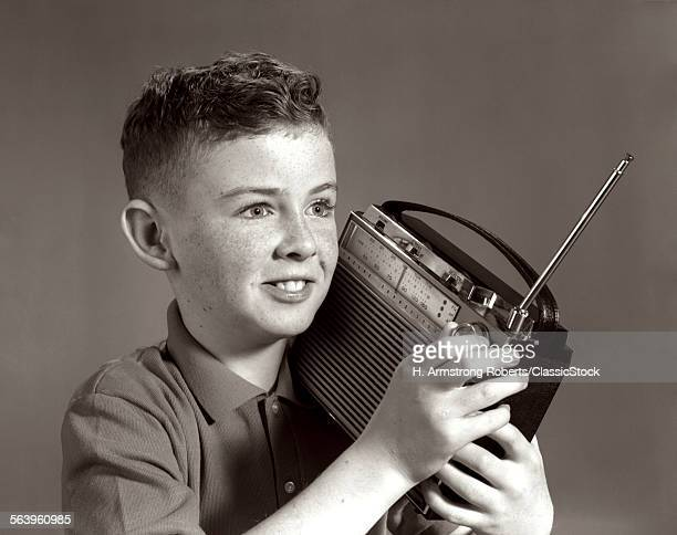 1960s BOY LISTENING TO...