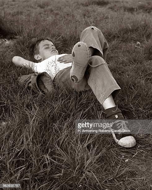 1960s BOY SLEEPING IN...
