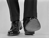 1960s CLOSE-UP MALE FEET...
