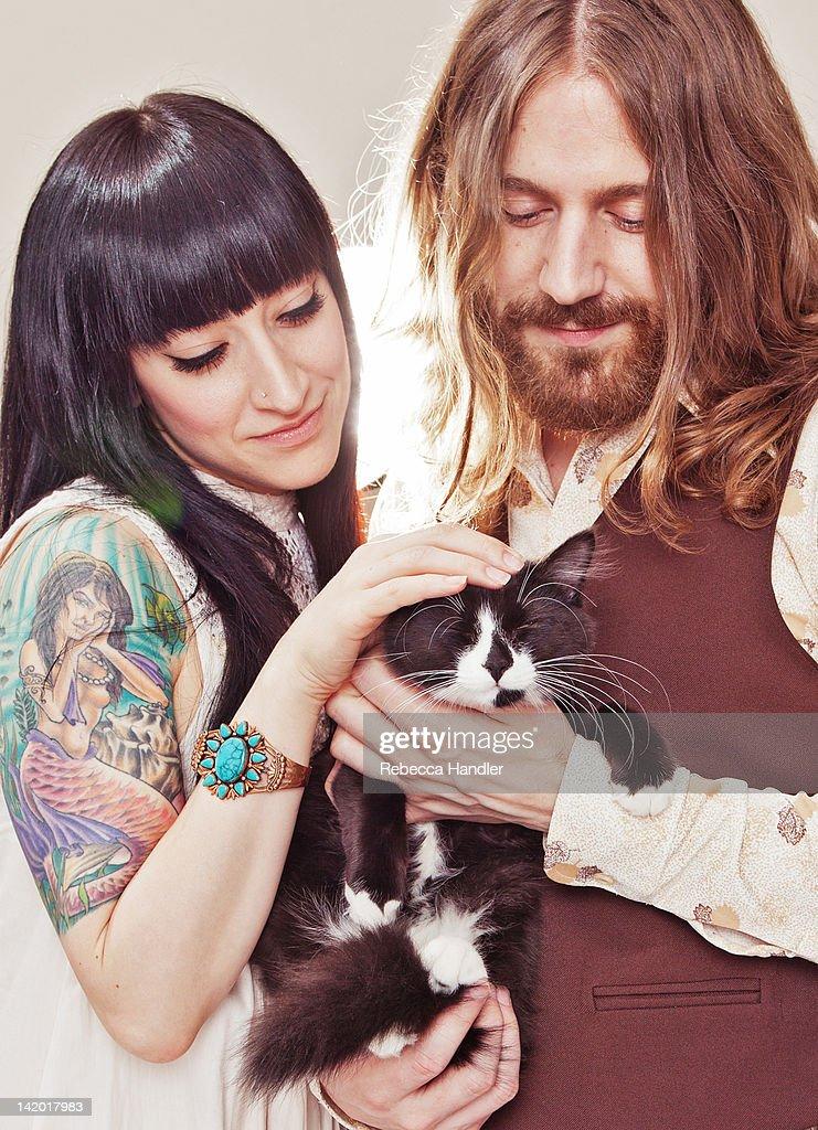 1960s couple engagement portrait with cat : Stock Photo