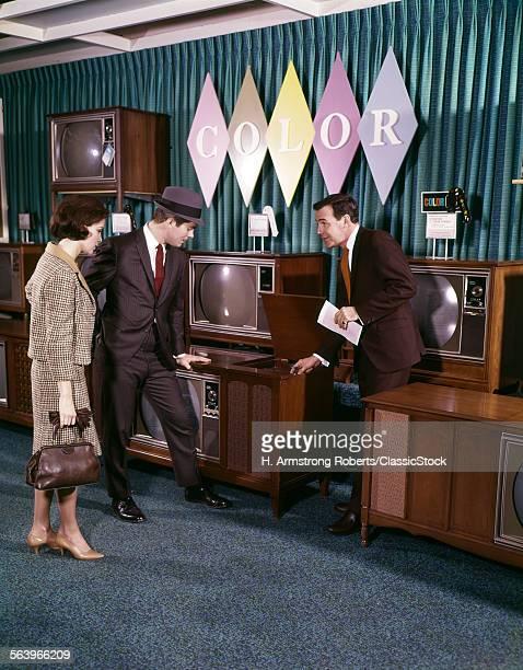 1960s COUPLE WITH SALESMAN...