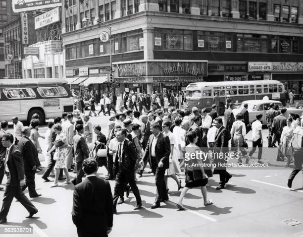 1960s CROWD CROSSING BUSY...