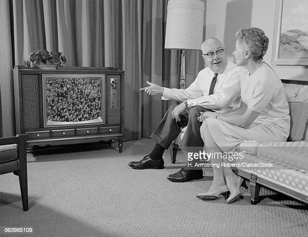 1960s ELDERLY COUPLE...