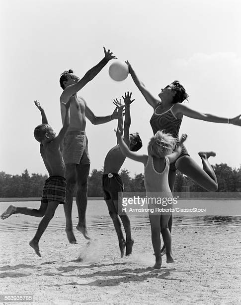1960s FAMILY JUMPING...