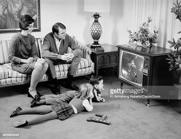 1960s FAMILY OF 4 WATCHING...