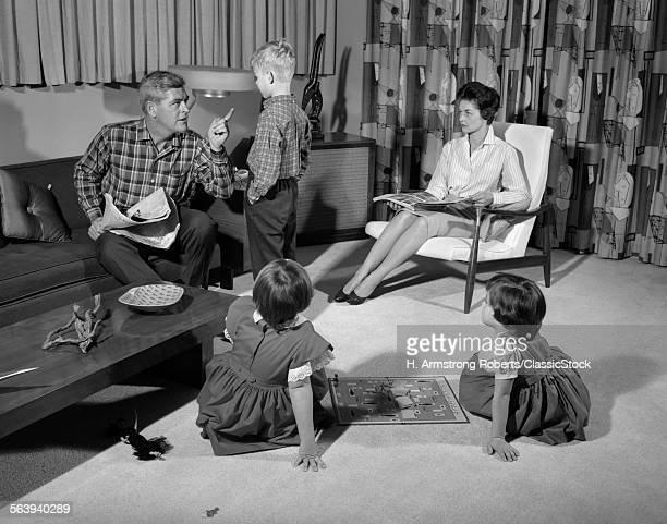 1960s FAMILY OF FOUR IN...