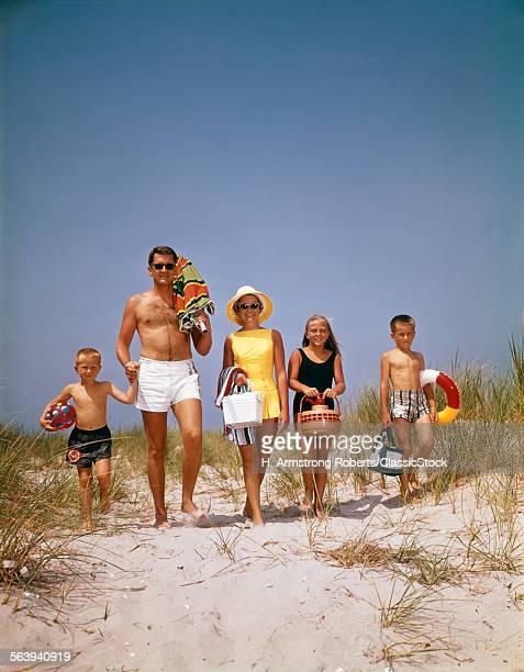 1960s FAMILY WALKING...