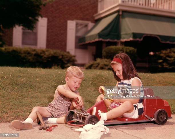 1960s GIRL SITTING IN RED...