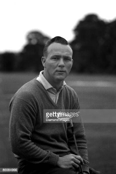 Golfer Arnold Palmer poses for a portrait holding an iron in the early1960s in Latrobe Pennsylvania