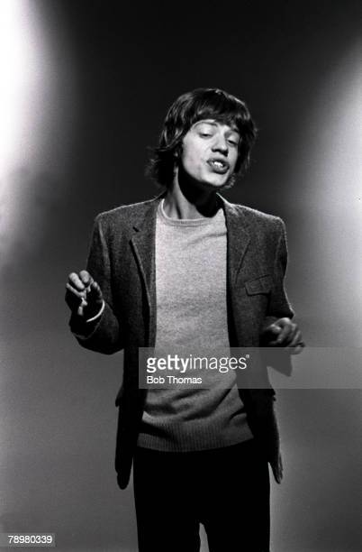 1960s Half length portrait of singer Mick Jagger of British pop group The Rolling Stones wearing a smart suit