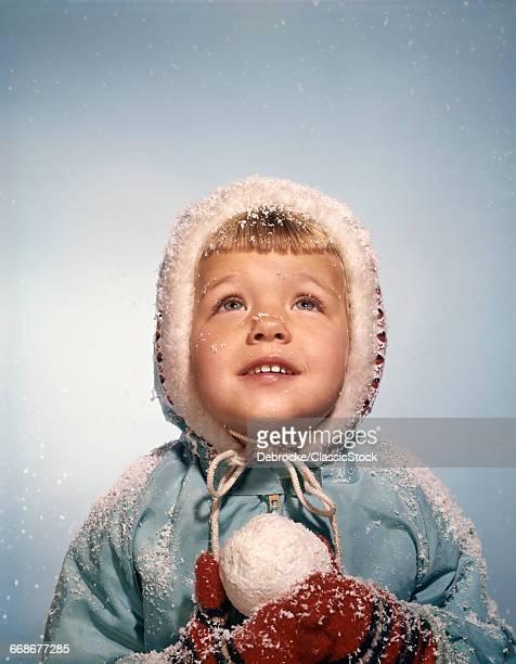 1960s LITTLE GIRL HOLDING...