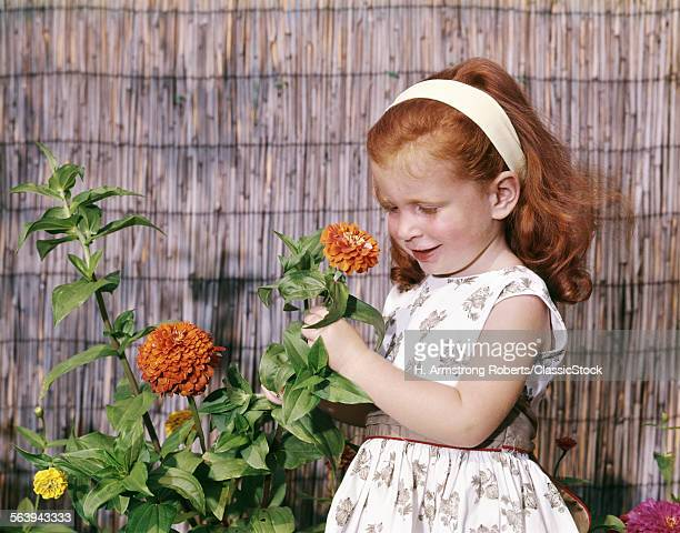 1960s LITTLE GIRL SMELLING...