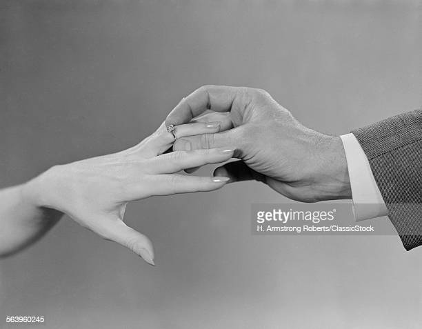 1960s MALE HAND SLIPPING...