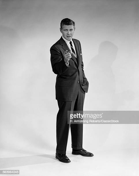 1960s MAN IN BUSINESS SUIT...