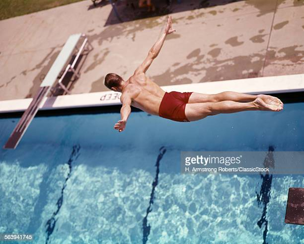 1960s MAN IN RED SWIM...