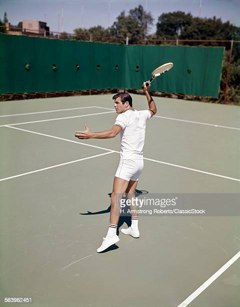 1960s MAN PLAYING TENNIS...