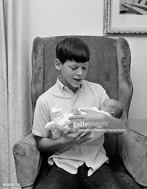 1960s PRE-TEEN BOY SITTING...