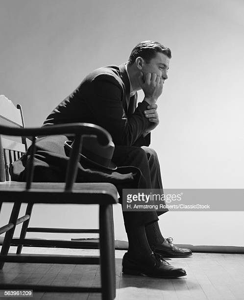 1960s SAD MAN RESTING HAND...