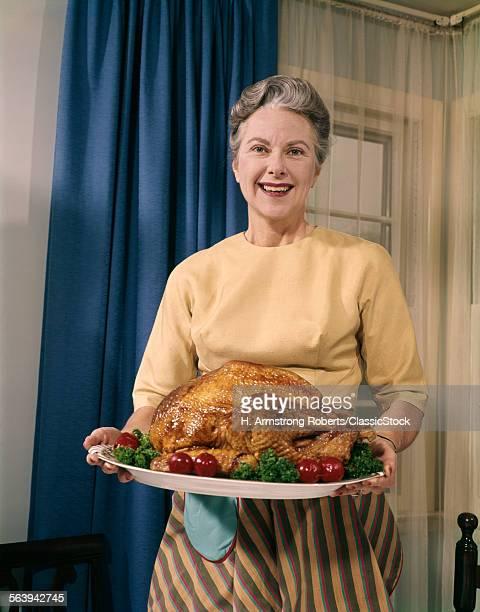 1960s SENIOR WOMAN SERVING...