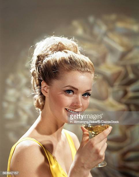 1960s SMILING BLOND WOMAN...
