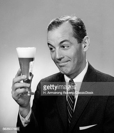 1960s SMILING MAN IN SUIT...