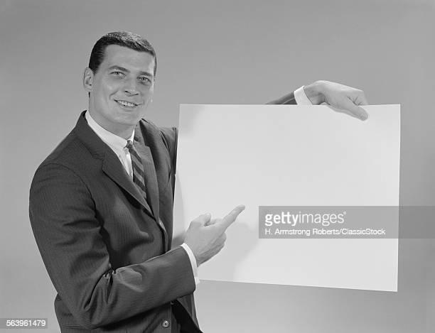 1960s SMILING MAN POINTING...