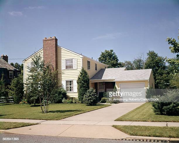 1960s TWO STORY YELLOW...