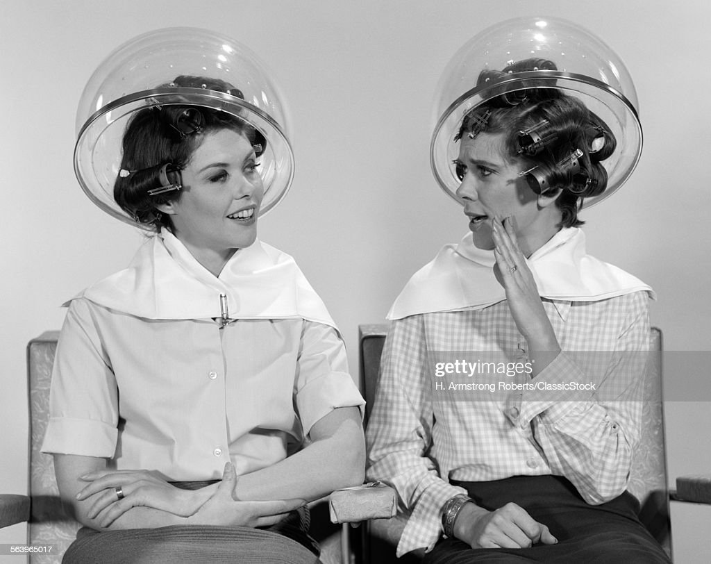 1960s TWO WOMEN SITTING... : Stock Photo