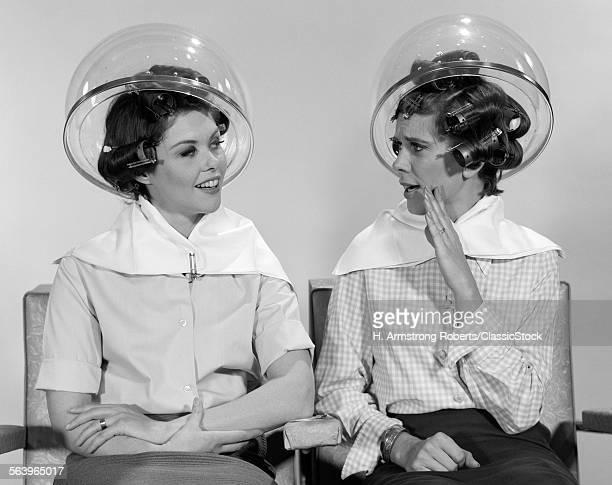1960s TWO WOMEN SITTING...