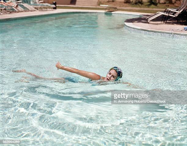 1960s WOMAN BLUE BATHING...