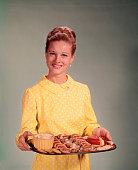1960s WOMAN HOLDING A TRAY...