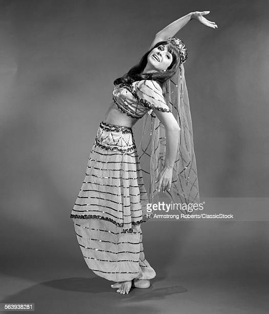 1960s WOMAN IN BELLY-DANCER...