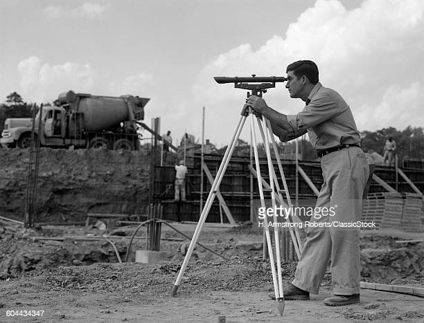 1960sIDE VIEW OF WORKER.