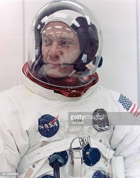 Kennedy Space Center FL While undergoing spacesuit checks Apollo 11 Lunar Module pilot Buzz Aldrin watches astronauts Neil A Armstrong and Michael...