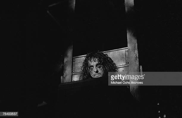 Alice Cooper with his head in a guillotine for his outrageous stage show in the mid 1970's in Los Angeles California
