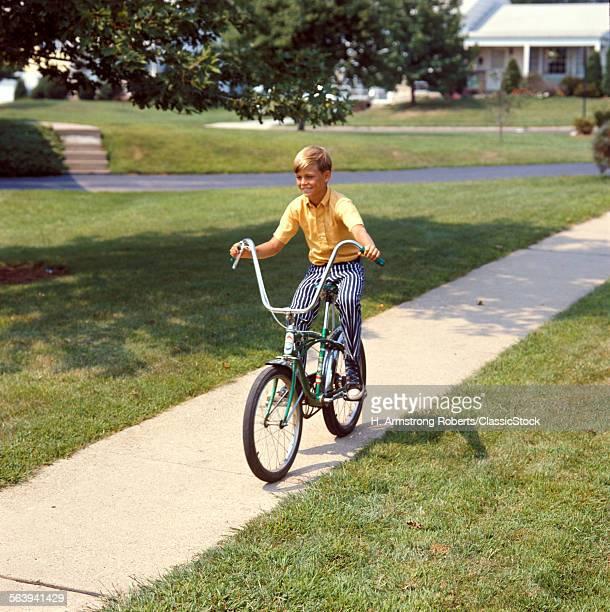 1970s BLOND BOY BIKING...