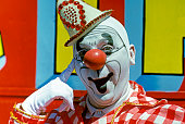 1970s CIRCUS CLOWN SMILING...