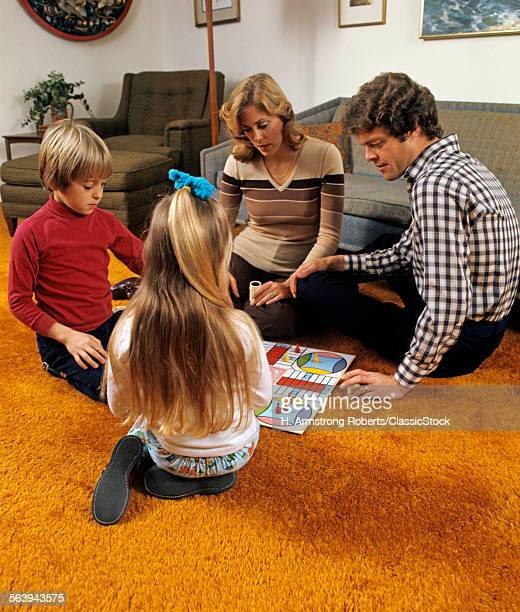 1970s FAMILY PLAYING...
