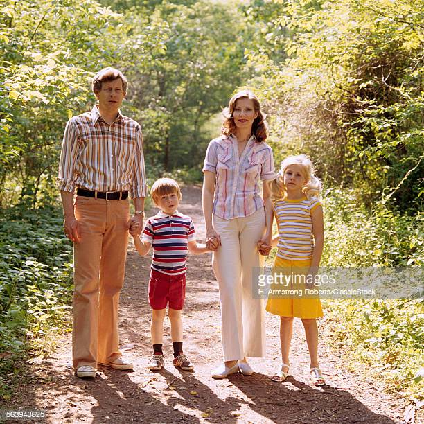 1970s FAMILY WALKING...