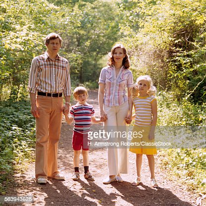 1970s FAMILY WALKING...