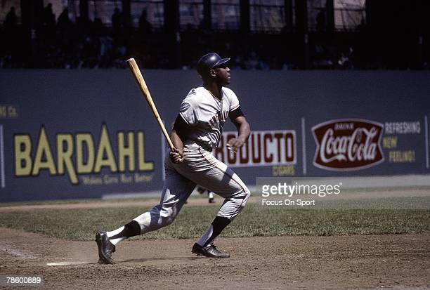 First baseman Willie McCovey of the San Francisco Giants swings and watches the flight of his ball during a circa 1970s Major League Baseball game...