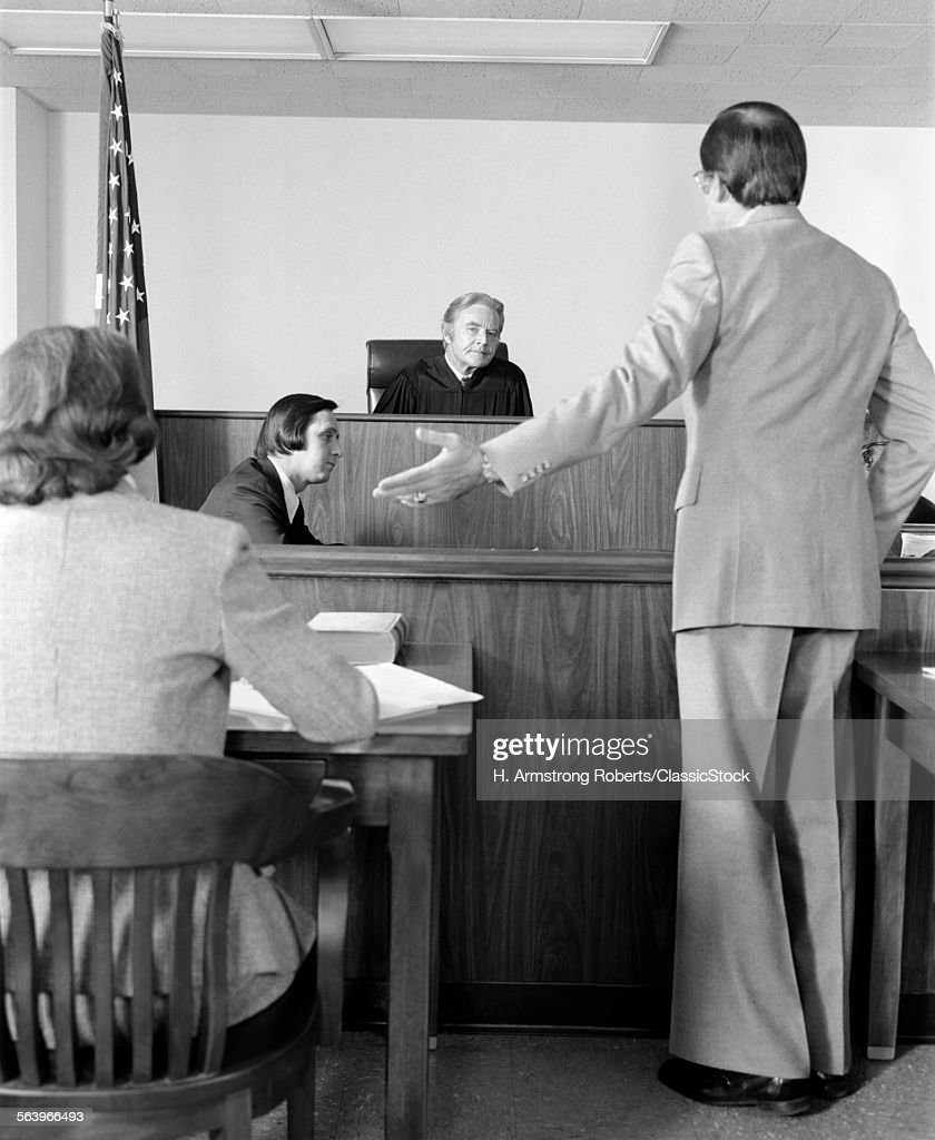 1970s LAWYER POINTING TO...