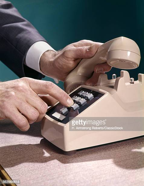 1970s MALE HANDS DIALING...